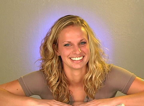 Beautiful Young Blonde with a Bright, Warm Smile Stock Video Footage
