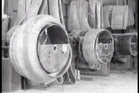 Men make tires in the Goodyear factory in 1920 Live Action