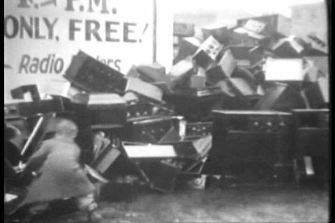 People burn their old obsolete radios in a giant b Footage