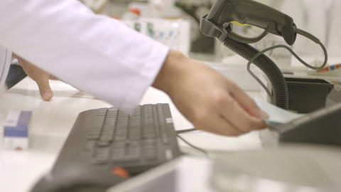 Male pharmacist scanning bar code through the bar code… Stock Video Footage