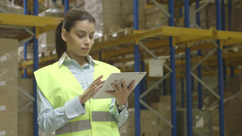 Young woman engineer using digital tablet in factory ライブ動画