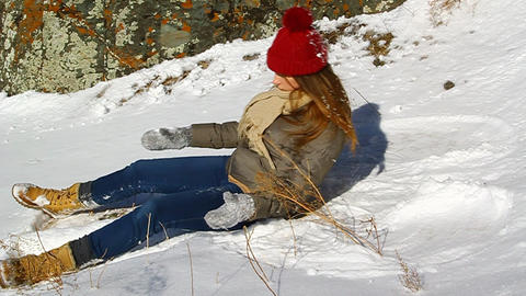 Young happy girl lying in the snow Footage
