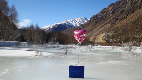 Blue gift package and the helium balloon is on the Footage