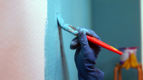Painting Walls. Close-up stock footage
