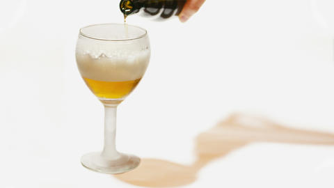 Pouring Glass With Beer Isolated On White stock footage