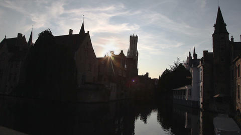 Houses and channel in Bruges, Belgium during sunse Footage