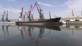 Unloading Cargo Vessel In Baku Harbor stock footage