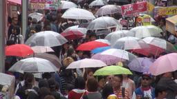 Shopping street in Tokyo Japan, holding umbrellas  Footage