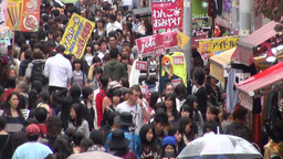 Busy, crowded shopping street in Tokyo city, Japan Footage