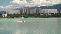 Almaty City, Lake Apartment Buildings, Speedboat stock footage
