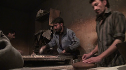 Making fresh bread in Pakistan bakery Footage