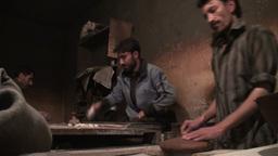 Making fresh bread in Pakistan bakery Footage