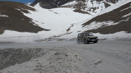 Lada Niva drives over mountain pass connecting Geo Footage