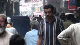 People walking through narrow Lahore street Footage