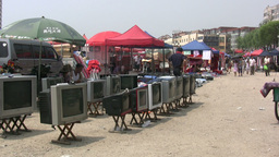 Selling second hand televisions at market in China Footage