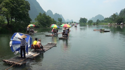 Tourists on rafts in karst scenery China Footage