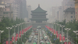 Traffic and pagoda covered in smog in China Footage