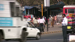 Business man in India crosses street Footage