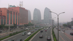 Traffic and smog in business district Beijing Chin Footage