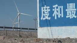 Trucks pass windmills in China Footage