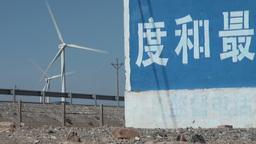 Trucks pass windmills in China Footage