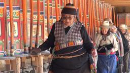 Walking past prayer wheels in Tibetan area in Chin Footage