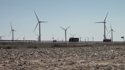 Wind turbines along Chinese express way Footage