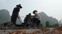 Workers using plough in karst scenery in China Footage