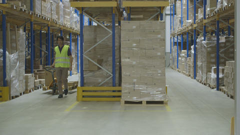 Warehouse worker loading cardboard boxes Footage