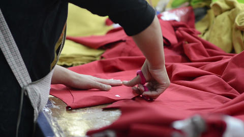 Cutting Red Fabric stock footage
