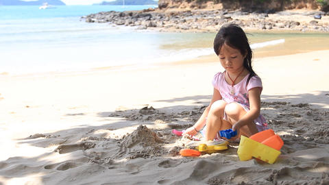 Little girl playing sand Footage