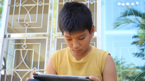 young boy using a digital tablet Footage