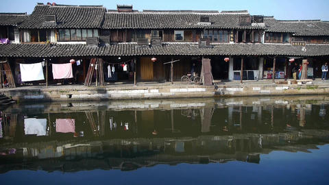 Traditional Chinese houses & bridge reflection on blue water,XiTang Water To Animation