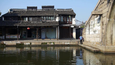 Chinese ancient hourse & bridge,old woman faltering,water town resident life Animation