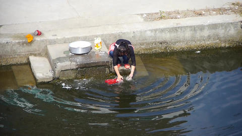 chinese woman wash cloths in river Animation