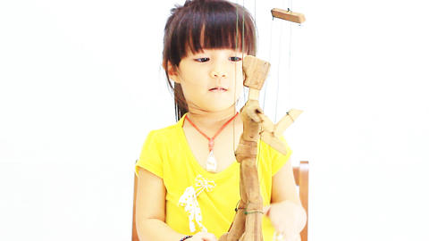 Little girl playing the marionette Live Action