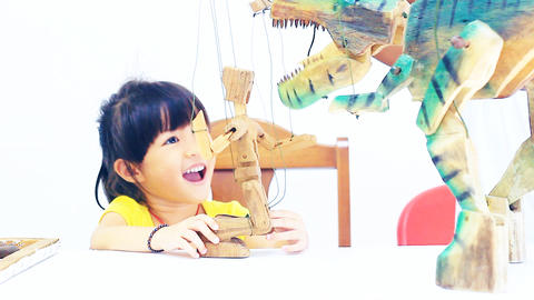 Little girl and young boy playing the marionette Footage