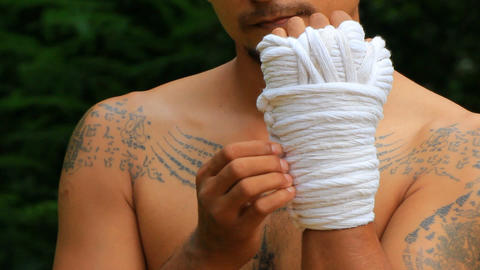 Wrapping the hands with rope Footage