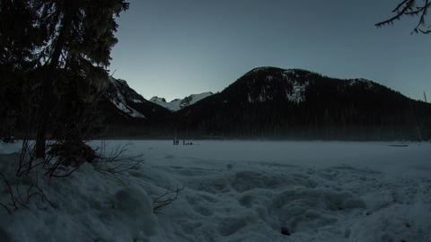 Motion dolly shot of people by snow mountain Footage