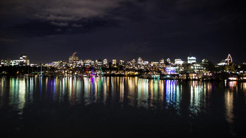 Pull focus shot of False Creek night traffic ビデオ