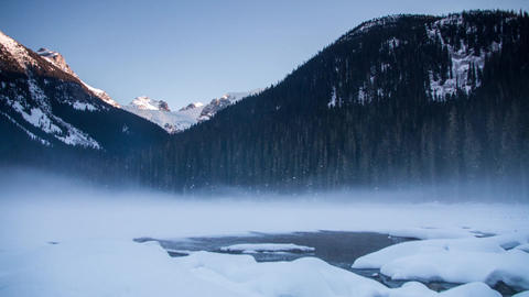 Winter fog at frozen Joffrey lake Footage