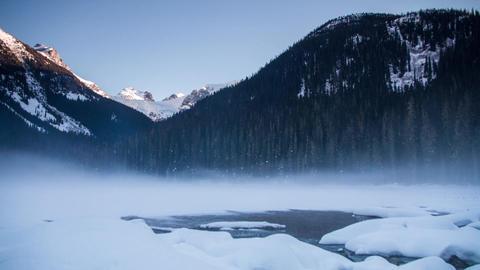 Winter fog at frozen Joffrey lake Footage