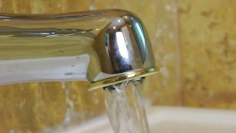 opening and closing Water tap with running water Footage