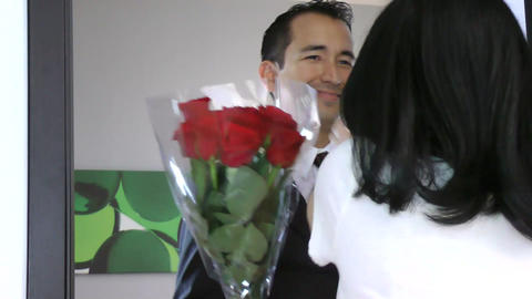 Handsome man giving a bouquet of red roses to his  Footage