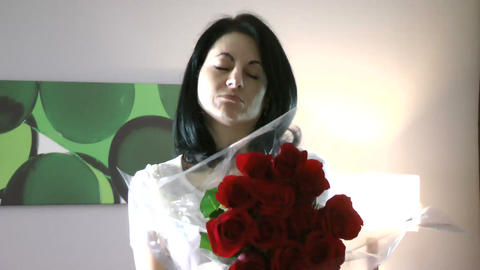 Beautiful woman giving flowers feeling guilty Footage