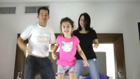 Family Jumping On Bed Together Footage