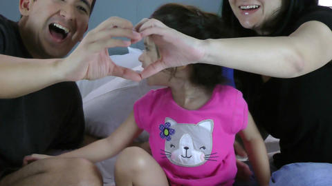 family making heart symbol from hands to their gir Footage