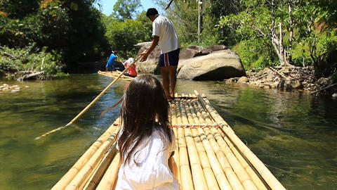 Bamboo rafting in the tropical forest Footage