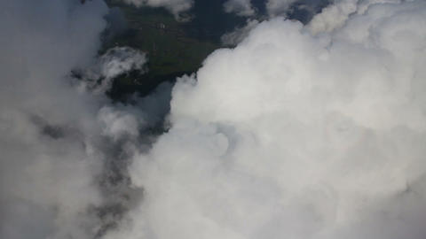 Airplane Flying Over City And Clouds, Shot From Th stock footage
