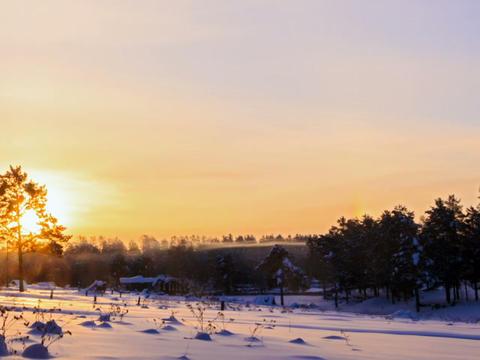 Sun rises over the winter landscape. Time Lapse. 6 Footage